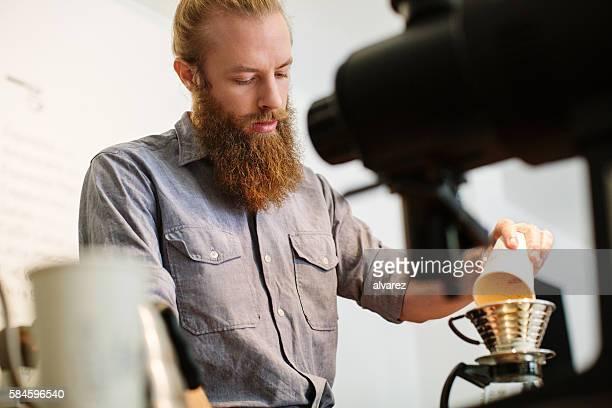 Barista preparing coffee at restaurant