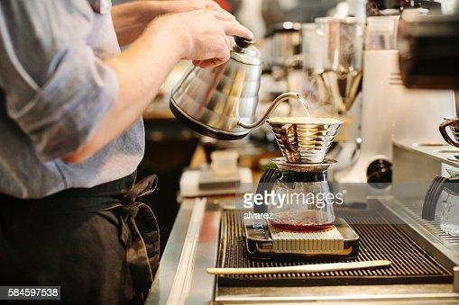 Barista preparing drip coffee