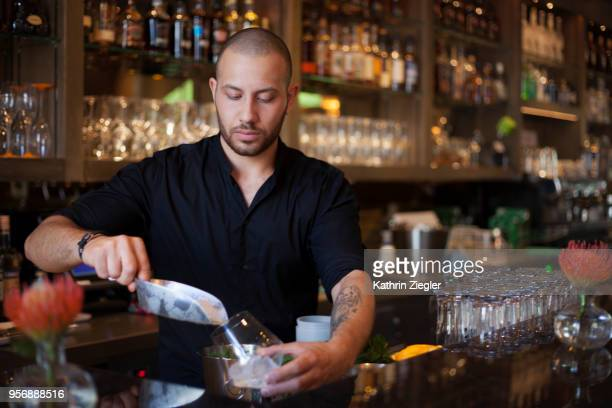 Barista preparing iced drink