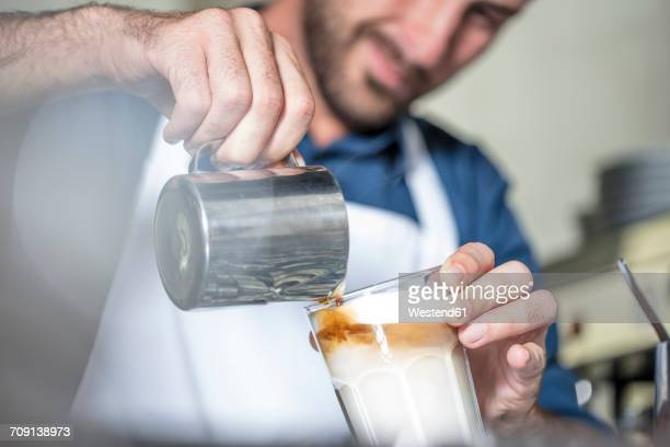 Barista preparing Latte Macchiato