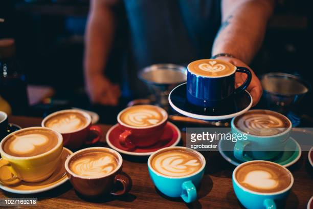barista serving coffee - saucer stock pictures, royalty-free photos & images