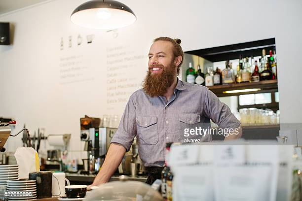 Barista standing at a coffee shop
