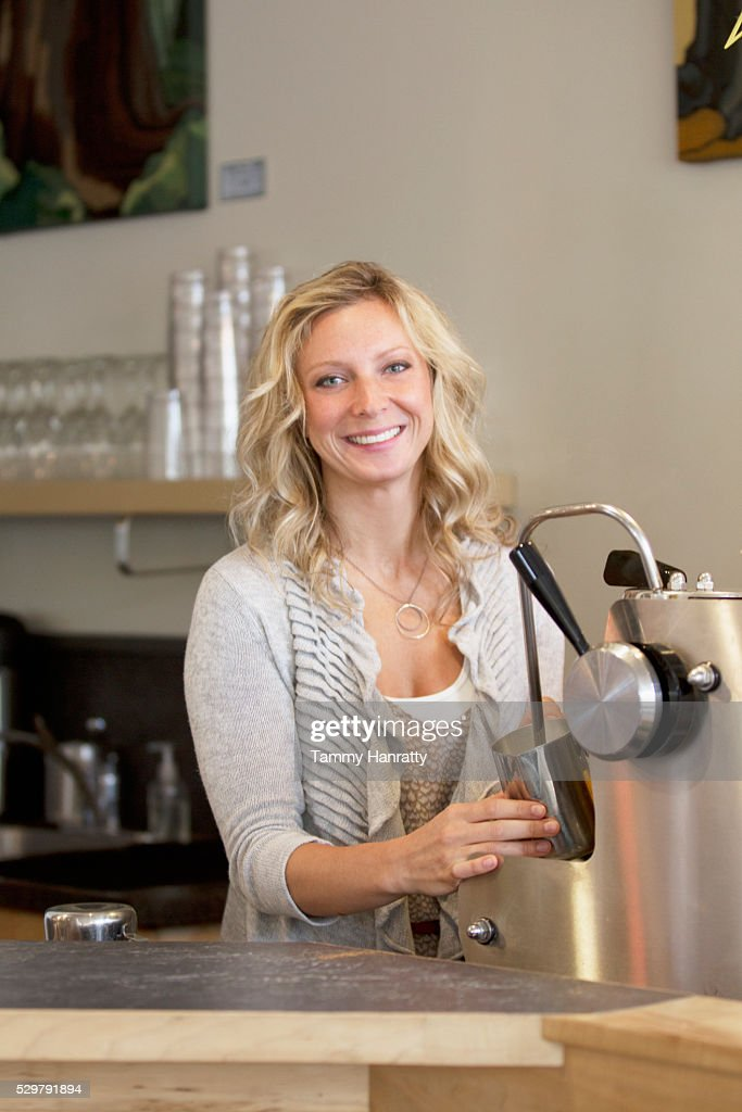 Barista steaming milk : Stock Photo