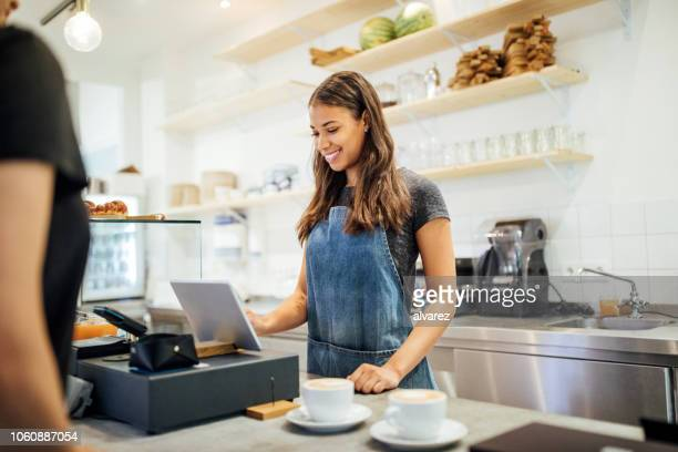 barista taking order from customer cafe - cashier stock pictures, royalty-free photos & images