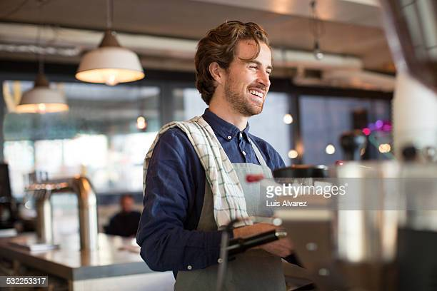 Barista working in coffee shop