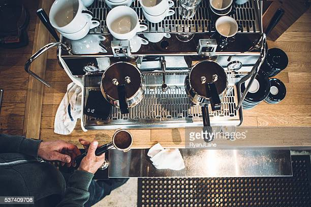 barista working on espresso machine - espresso stock photos and pictures