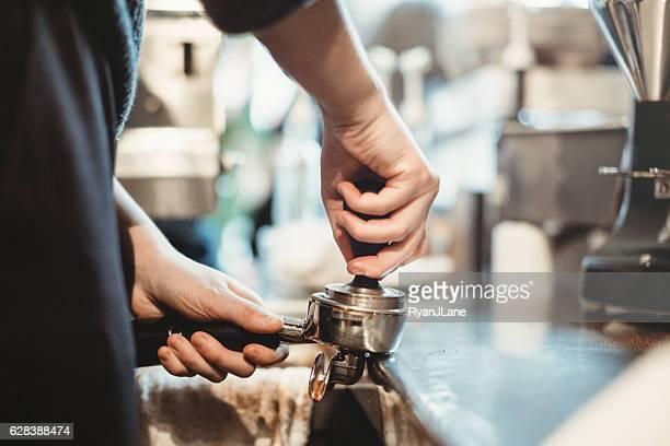 Barista Working on Espresso Machine