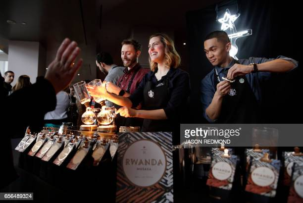 Baristas brew siphon coffee at Starbucks' Annual Meeting of Shareholders at McCaw Hall in Seattle Washington on March 22 2017 / AFP PHOTO / Jason...