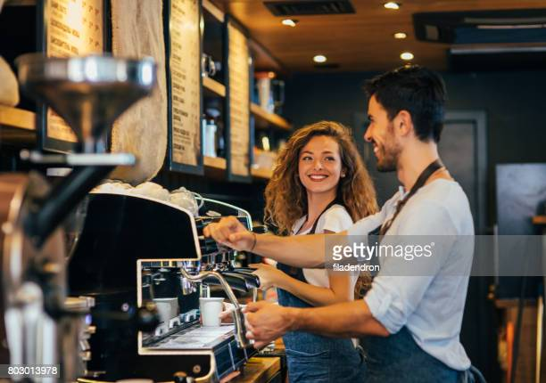 baristas making coffee - coffee grinder stock photos and pictures