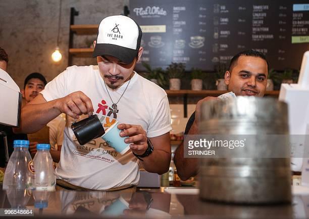 Baristas prepare orders at the 'Flat White' cafe in the Qatari capital Doha's Tawar Mall on June 8 2018 Tawar Mall looks like any of Qatar's...