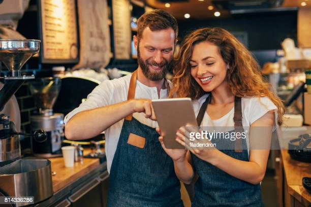 Baristas using a tablet