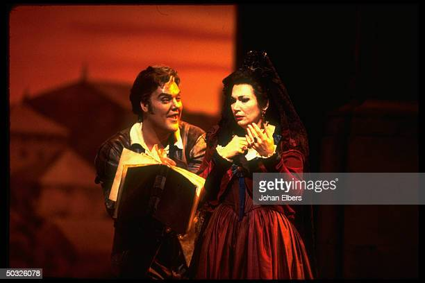Baritone Bryn Terfel as Leporello singing the famous Catalogue aria w. Soprano Carol Vaness as Donna Anna in Mozart's Don Giovanni on stage at the...