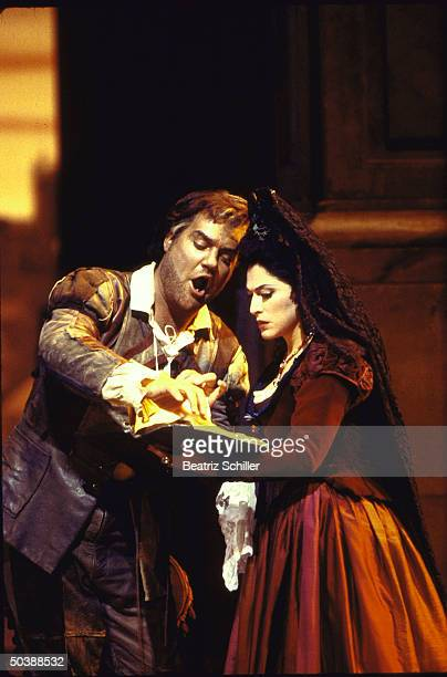 Baritone Bryn Terfel as Loporello w. Unident. Soprano sings the Catalog Aria in a scene fr. Mozart's 'Don Giovanni on stage at the Metropolitan Opera.