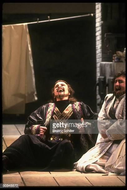 Baritone Dwayne Croft as Guglielmo w unident soprano in Mozart's Cosi Fan Tutte on stage at the Metropolitan Opera