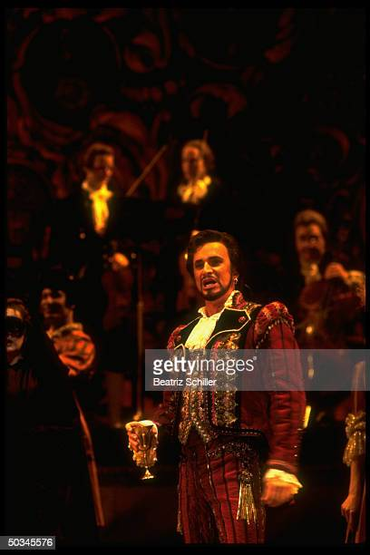 Baritone Dwayne Croft in the title role of Mozart's Don Giovanni w other singers on stage at the at the Metropolitan Opera