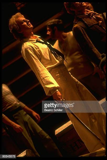 Baritone Dwayne Croft singing the title role in Britten's Billy Budd on stage at the Metropolitan Opera