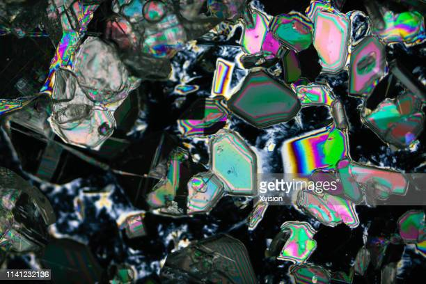 barium chloride under polarized light with black background - magnification stock pictures, royalty-free photos & images
