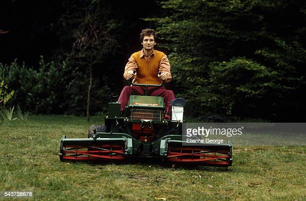 Barjo played by Hippolyte Girardot on a riding mower in a scene from the 1992 French film Confessions d'un Barjo directed by Jerome Boivin Also...