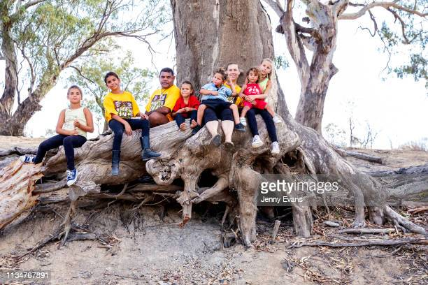 Barkandji man and independent candidate for the seat of Barwon Owen Whyman and his family pose for a portrait on the dry bed of the Darling Barka...