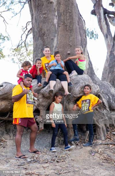 Barkandji man and independent candidate for the seat of Barwon, Owen Whyman and his family pose for a portrait on the dry bed of the Darling -Barka...