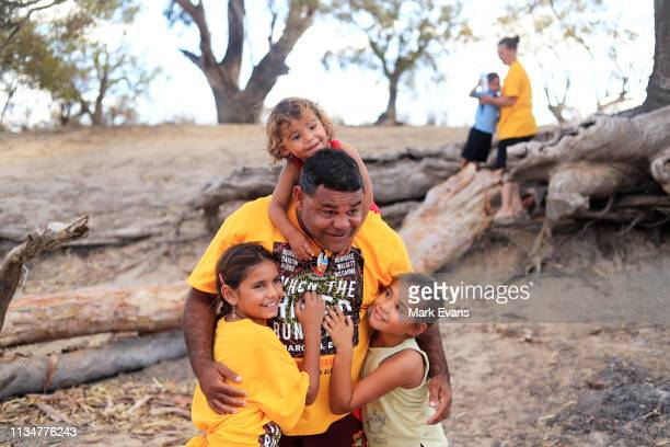 Barkandji man and independent candidate for the seat of Barwon Owen Whyman is hugged by his kids on the dry bed of the Darling Barka river on March...