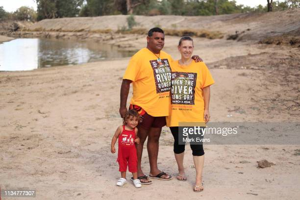 Barkandji man and independent candidate for the seat of Barwon, Owen Whyman looks on with his child, Kaakuru and partner Rebecca Hatch on the dry bed...