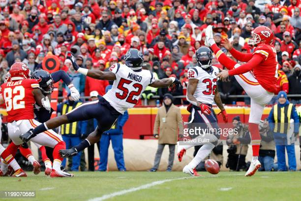 Barkevious Mingo of the Houston Texans blocks the kick by Dustin Colquitt of the Kansas City Chiefs that was recovered by Lonnie Johnson Jr. #32 and...