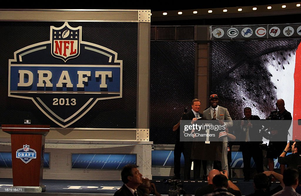 Barkevious Mingo of the LSU Tigers stands on stage with NFL Commissioner Roger Goodell as they hold up a jersey on stage after Mingo was picked #6 overall by the Cleveland Browns in the first round of the 2013 NFL Draft at Radio City Music Hall on April 25, 2013 in New York City.