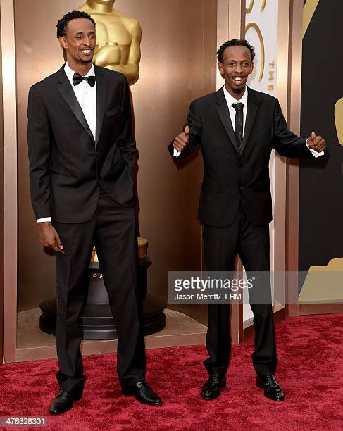 Barkhad Abdi and Faysal Ahmed attend the Oscars held at Hollywood Highland Center on March 2 2014 in Hollywood California