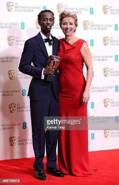 Barkhad Abdi winner of the best supporting actor award poses in the winners room with Emma Thompson at the EE British Academy Film Awards 2014 at The...