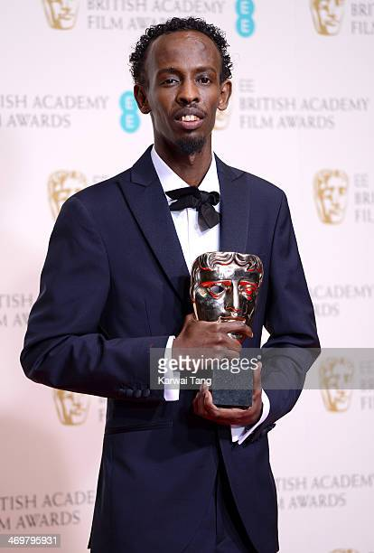 Barkhad Abdi winner of the best supporting actor award poses in the winners room at the EE British Academy Film Awards 2014 at The Royal Opera House...