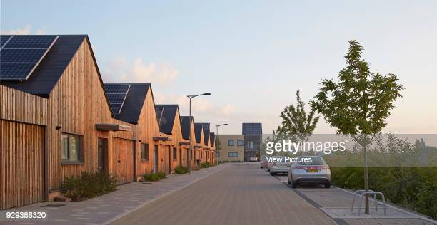 Barking Riverside Housing Development Barking United Kingdom Architect Sheppard Robson 2014 Perspective of street and terrace