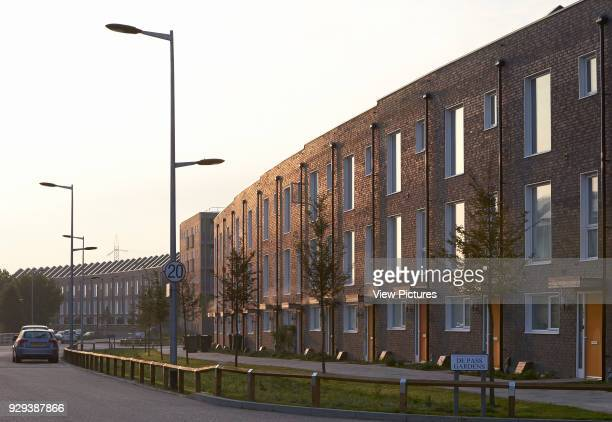 Barking Riverside Housing Development Barking United Kingdom Architect Sheppard Robson 2014 Curved terrace with street in evening light