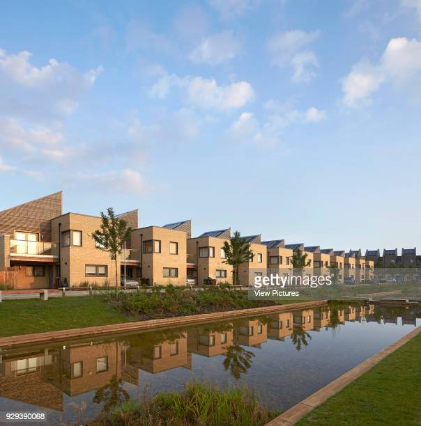 Barking Riverside Housing Development Barking United Kingdom Architect Sheppard Robson 2014 Perspective of housing terrace with reflection in creek
