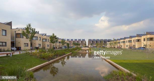 Barking Riverside Housing Development Barking United Kingdom Architect Sheppard Robson 2014 Communal garden with creek and terraces on either side