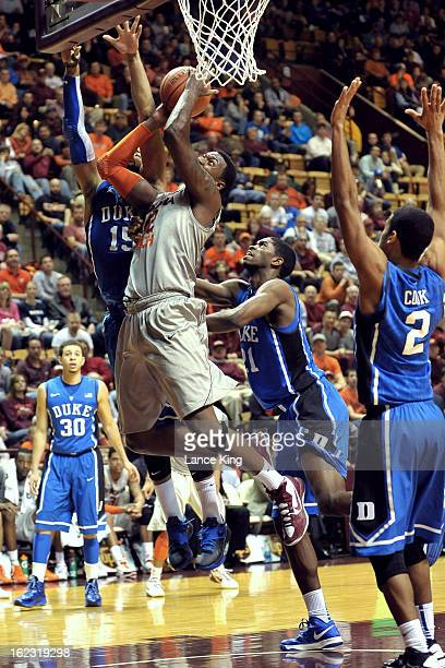 J Barksdale of the Virginia Tech Hokies goes to the hoop against Josh Hairston and Amile Jefferson of the Duke Blue Devils at Cassell Coliseum on...