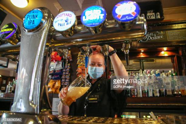 Barmaid prepares beer for a customer in a Pub. It has been reported that the UK government is likely to make changes to two pub rules when the Prime...