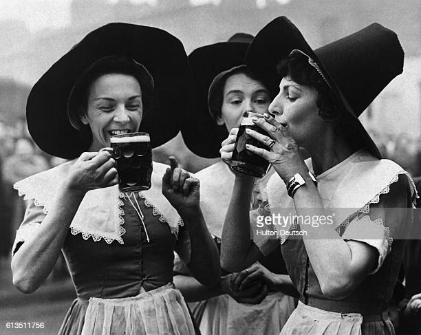 Barmaids in costume from the Festival Inn East London which is being built as part of the 1951 Festival of Britain The Inn will be a live...