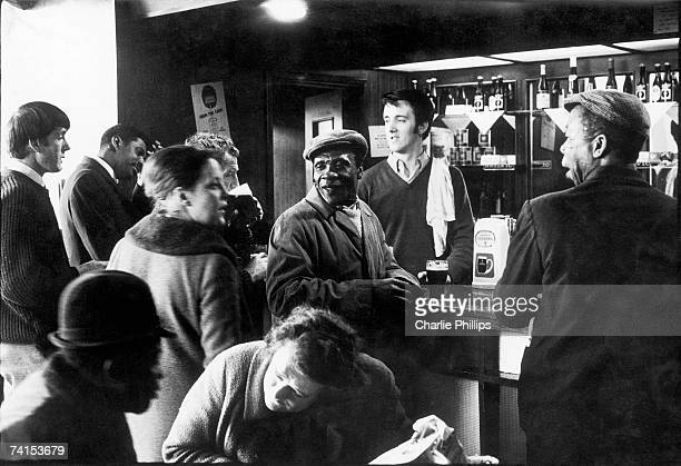 Barman and customers at the 'Piss House' pub on the Portobello Road, Notting Hill, London, 1969.