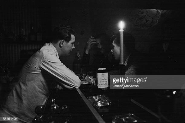 A barman listens to his patrons at a bar in Soho London 16th July 1955 Original publication Picture Post 7855 London's Little Europe pub 1955