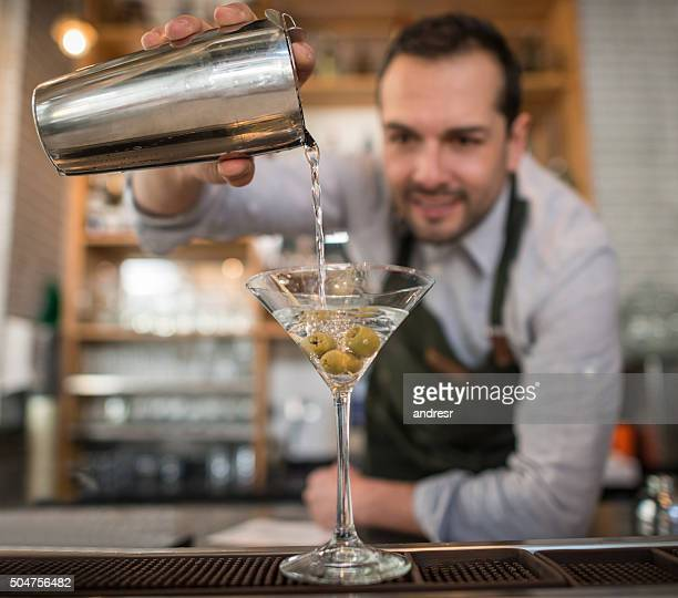 Barman making a martini cocktail