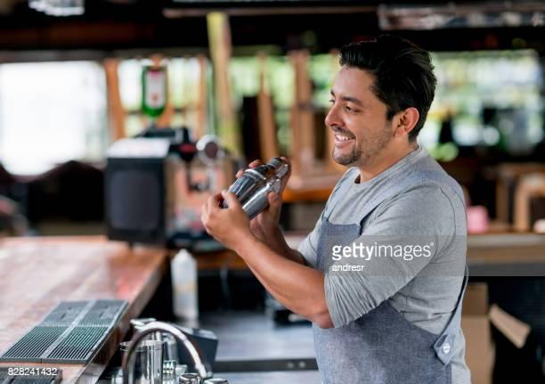 Barman mixing drinks at the bar