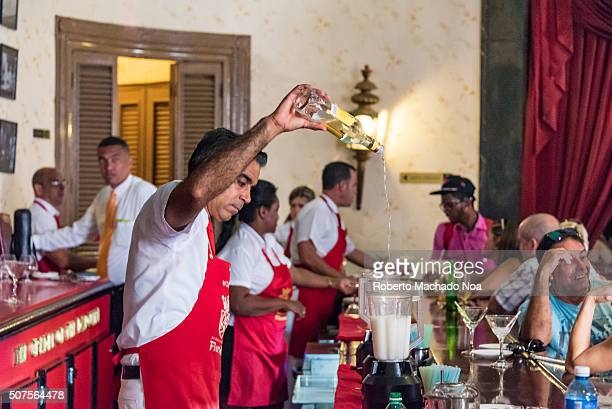 Barman or mixologist makes the worldly famous Daiquiri cocktail customers or patrons