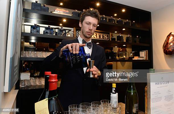 Barman pours Haig Club whisky during the opening of the new Thom Sweeney RTW & MTM Store on November 13, 2014 in London, England.