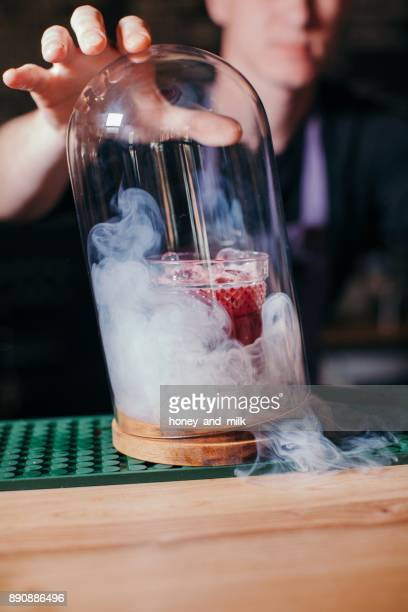 Barman preparing a smoky cocktail