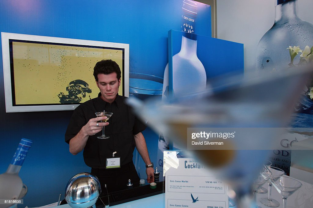 A barman serves a Grey Goose vodka martini at the first Barman's festival held for food and drink professionals on July 1, 2008 in Tel Aviv, Israel. For three nights, Israel's leading bar and restaurant staff were treated to cocktails and testing's of some of the best imported vodkas, whiskies and beers imported into the Jewish State.