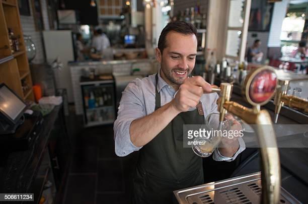 Barman serving draught beer