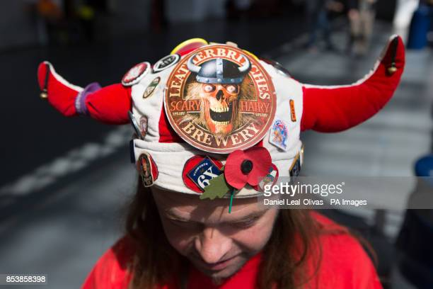 A barman with a 'viking' hat at the Great British Beer Festival at Olympia London where Prince Harry made an unofficial visit yesterday