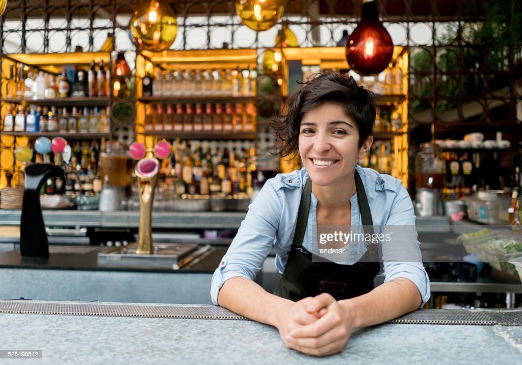 Barman working at a bar : Stock Photo