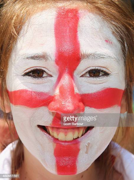 Barmy Army member with facepaint poses during day one of the First Ashes Test match between Australia and England at The Gabba on November 21 2013 in...